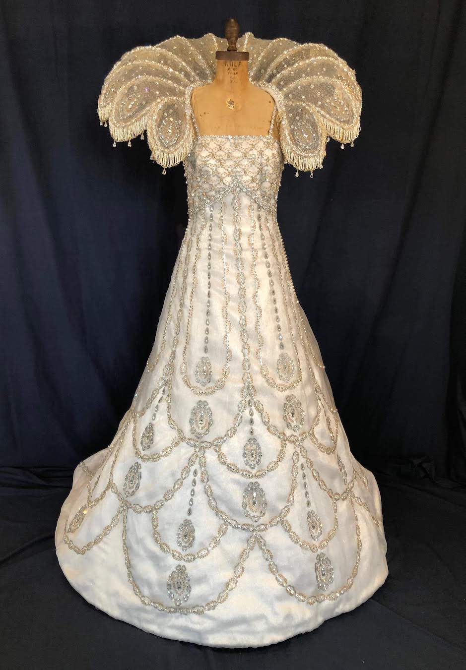 embossed Queen's gown antique white with silver and gold embossed gown & collar front view